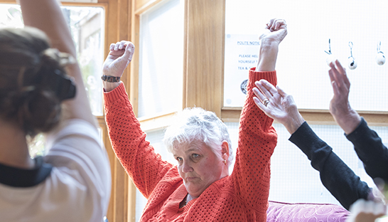Duchess of Kent residents stretching during physiotherapy