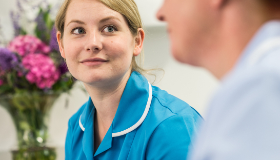 Sue Ryder Nurse at Leckhampton gazing at other nurse