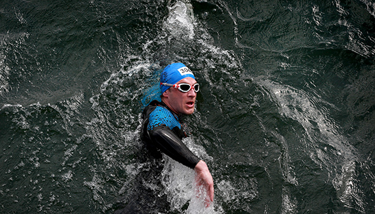A Sue Ryder supporter doing the Eton Swim Series