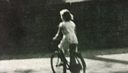 Lady Ryder as a child on a bicycle