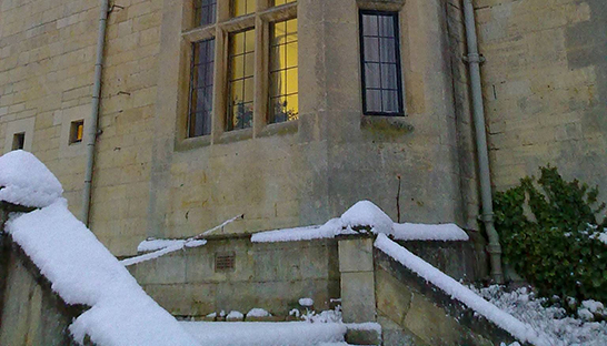 The windows of Leckhampton Court Hospice covered with snow