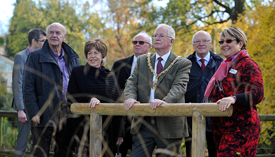 The Mayor, Hospice Director Elise Hoadley and Trustees look out across the grounds.