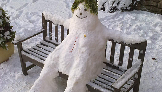 The snowman at Leckhampton with grass for hair