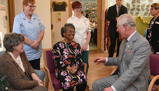 Patients Beverly Creary (centre) and Patricia Adkins (far left), and Nursing Assistant Gerri Garrot (left) and Occupational Therapist Heather Bayliss (right) share a joke with HRH Prince Charles.
