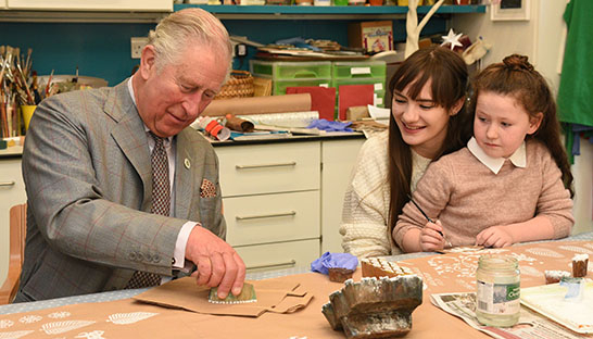 His Royal Highness takes part in some Christmas crafts with Hollie Bishop and Lara Elliott