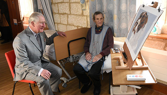 Patient Victor Neave meets His Royal Highness who admires his artwork.