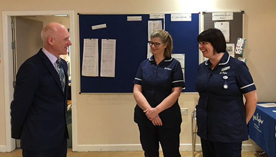 Photo of the Scottish Government's Minister for Public Health, Joe FitzPatrick MSP, visiting Sue Ryder Dee View Court to meet nursing staff