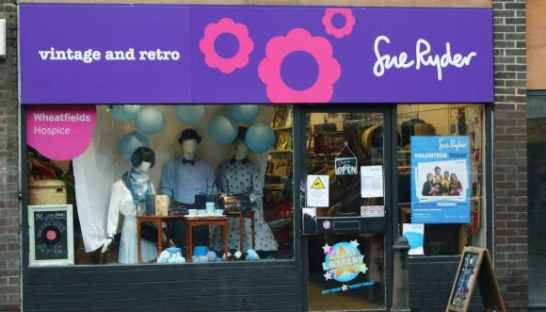 "Front of the Headingley Sue Ryder shop ""vintage and retro"" features on the signage"
