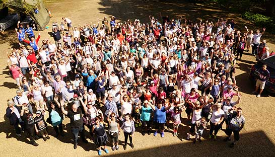 Aerial shot of a crowd of Sue Ryder supporters taking part in Thorpe Hall Hospice's Walk to Remember 2018