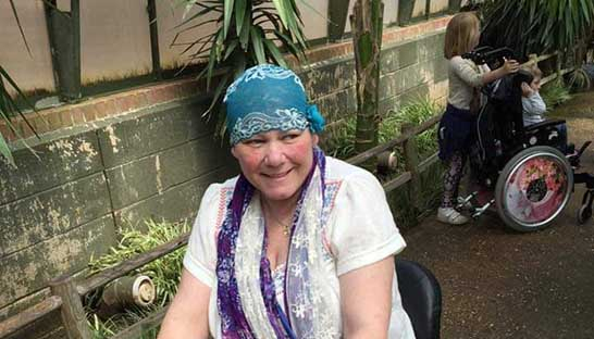 Sue Ryder Thorpe Hall Hospice patient Tracey Goodacre enjoying the hospice's gardens