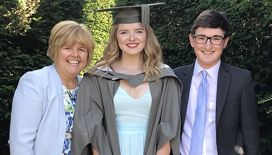 Jess Bacon with her Mum and brother at her graduation.