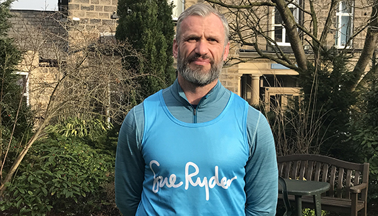 Jamie Peacock in his blue Sue Ryder running vest