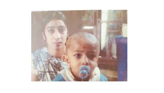 Nilesh with his mother as a baby