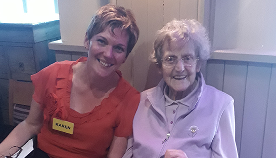 Sue Ryder Homecare Stirling Manager Karen Gray with an older lady at the intergenerational afternoon tea