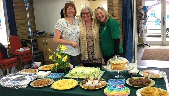 Organisers of Carers' Thursday with their cakes