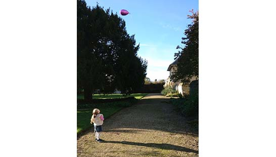 Five-year-old Isla Rayner releasing a balloon for Nanny in heaven in Thorpe Hall grounds
