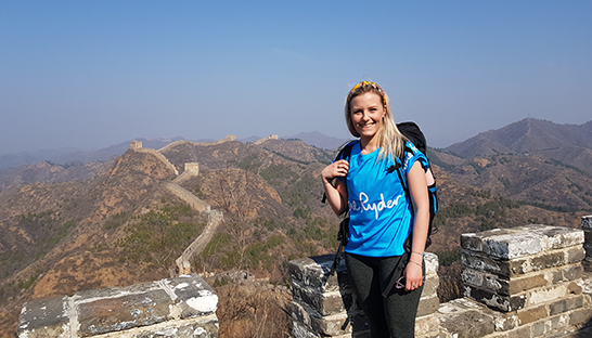 Hayley pictured with the Great Wall of China mountains