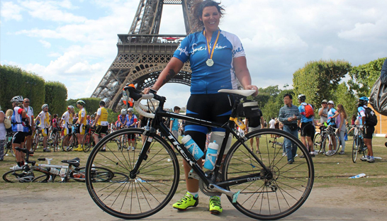 Michelle with her bike having completed the London to Paris cycle in support of Sue Ryder Manorlands Hospice