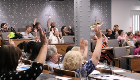 Audience with their hands in the air