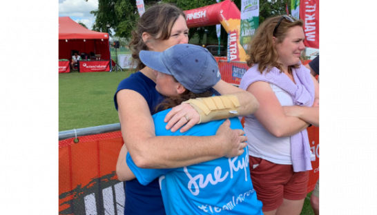 Kate hugs a friend at the finish line of the Cotswold Way Ultramarathon