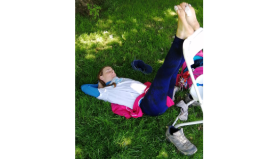 Kate Carr rests her feet during the ultramarathon