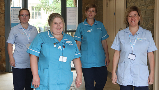 Sue Ryder Thorpe Hall Hospice at Home team standing in hall