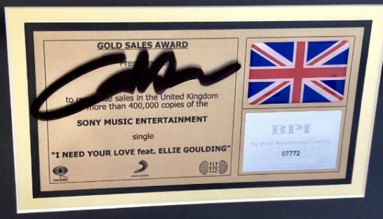 Calvin Harris's signed Gold Sales Award for I Need Your Love
