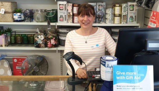 Sharon Wotherspoon behind the till at Sue Ryder's Mengham shop in Hayling Island