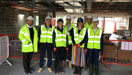 Image of Sue Ryder Chief Executive, Heidi Travis, and members of the team on site visit to new Sue Ryder Neurological Care Centre Lancashire