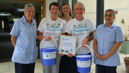 Sue and Pete Woolfitt with Community Fundraiser Victoria Potter and Sue Ryder Nurses