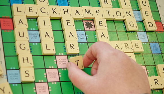 A Scrabble board with game in process