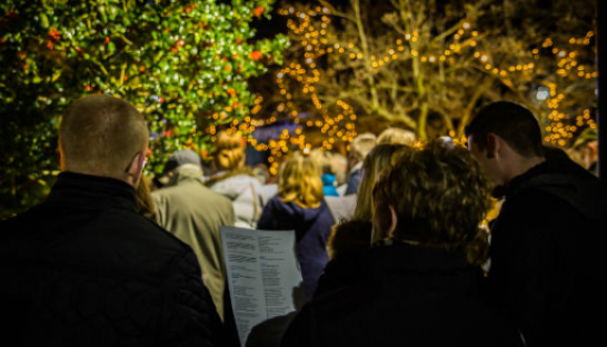 People singing carols at Wheatfields Lights of Love