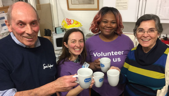Four volunteers with tea cups from the Bury St. Edmunds Charity Shop