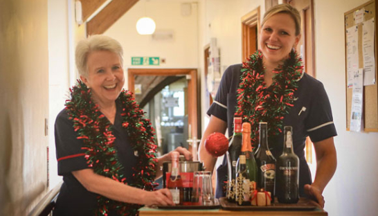 Leckhampton Nurses at Christmas with Drinks Trolley and Tinsel