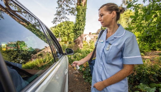 A Sue Ryder nurse travelling to a Hospice at Home appointment