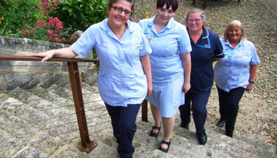 Sue Ryder nurses Cath Shatford, Bex Pearce and Heather Mitchell on the steps of the hospice