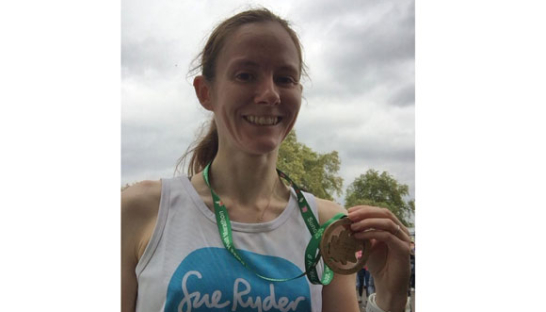 Kirsty McEwan with her medal after the Royal Parks Half Marathon
