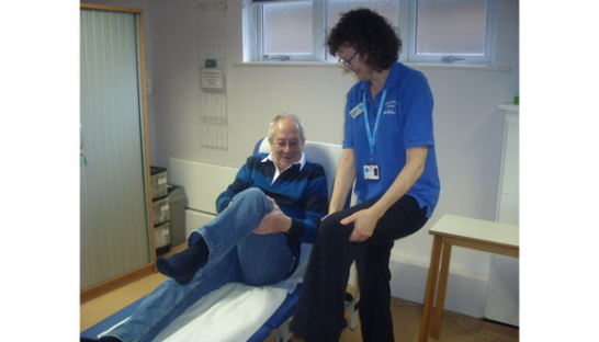 John Allin is shown movements to encourage lymph fluid to drain better at Sue Ryder Wokingham Day Hospice.