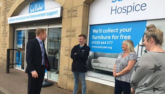Staff with local MP Robbie Moore outside the new Keighley Sue Ryder shop