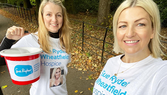 Two Sue Ryder Wheatfields Hospice supporters with their donation bucket