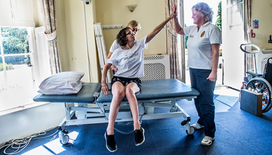 A resident doing assisted exercises during a physiotherapy session at The Chantry