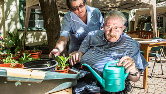 A Chantry resident out gardening with the help of a Sue Ryder Nurse.