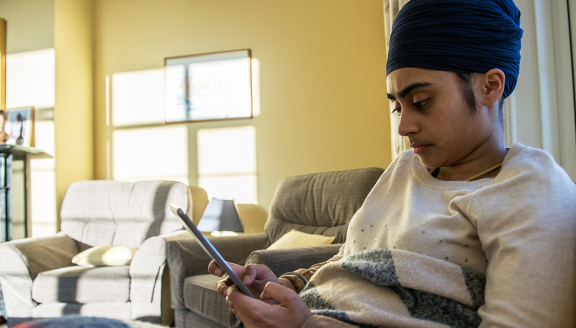 A user on a tablet accessing the online bereavement support from home
