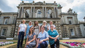 Staff pose in front of the Grade II listed The Chantry care centre