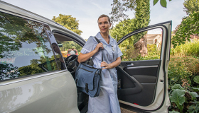 Sue Ryder Hospice at Home Nurse getting out of car