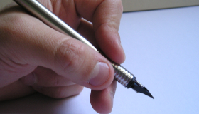 Image of a hand holding a pen