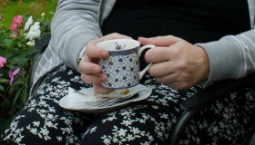 Photo of someone holding a tea cup - Sue Ryder advice and support information