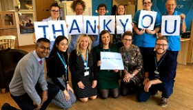 Image of staff at Thorpe Hall Hospice saying thank you