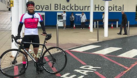 Image of Sue Ryder supporter, John, with his bicycle