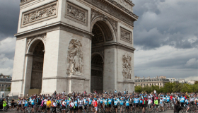 Cyclists infront of the Arc de Triomphe having completed the London to Paris cycle